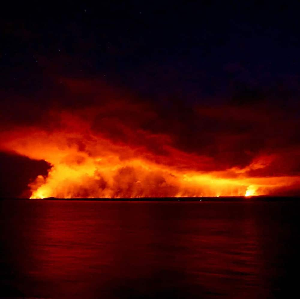Nighttime sail past Kilauea Volcano – Big Island
